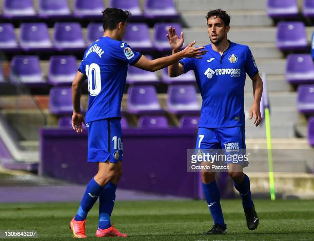 Jaime Mata of Getafe CF celebrates with teammate Enes Uenal after scoring his team's first goal during the La Liga Santander match between Real...