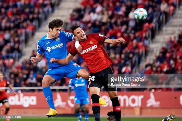 Jaime Mata of Getafe CF shooting against Martin Valjent of RCD Mallorca during the Spanish League La Liga football match played between RCD Mallorca...