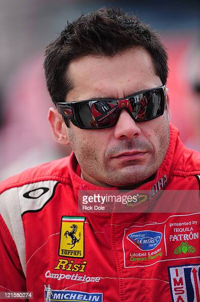 Jaime Melo of Brazil and driver of the Risi Competizione Ferrari 458 Italia on the pre race grid during the American Le Mans Series Time Warner Cable...