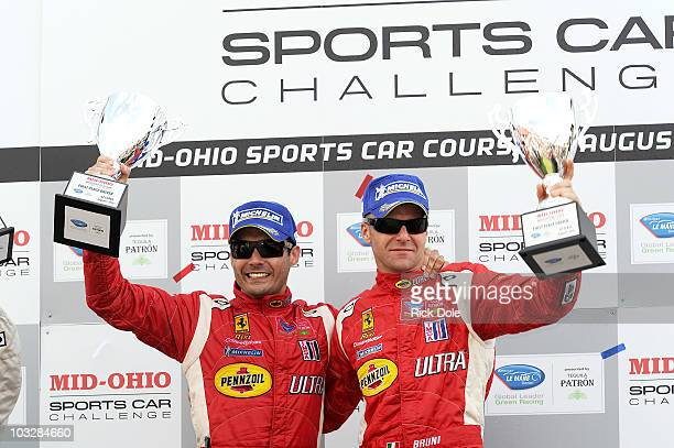 Jaime Melo of Brazil and Gianmaria Bruni of Italy celebrate their GT class victory in the Risi Competizione Ferrari 430 GT during the American Le...