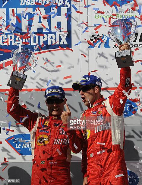 Jaime Melo of Brazil and Gianmaria Bruni of Italy drivers of the Risi Competizione Ferrari 430 GT celebrate their GT class victory during the...
