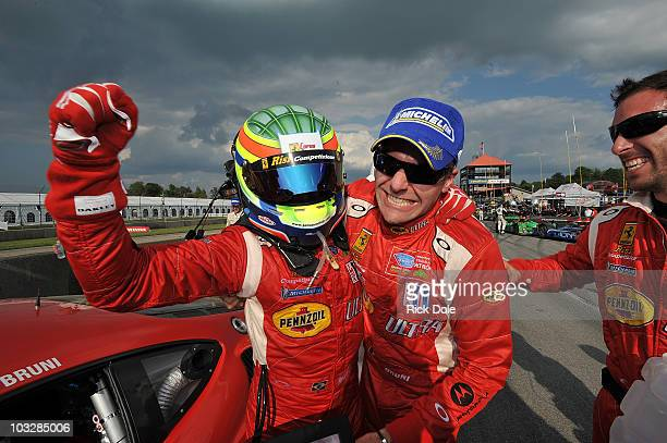 Jaime Melo of Brazil and Gianmaria Bruni of Italy drivers of the Risi Competizione Ferrari celebrate their victory in the GT class during the...