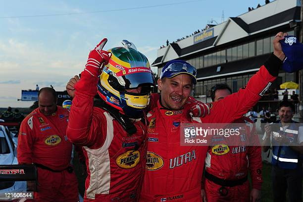 Jaime Melo of Brazil and Toni Vilander of Finland and drivers of the GT class winning Risi Competizione Ferrari 458 Italia following the American Le...