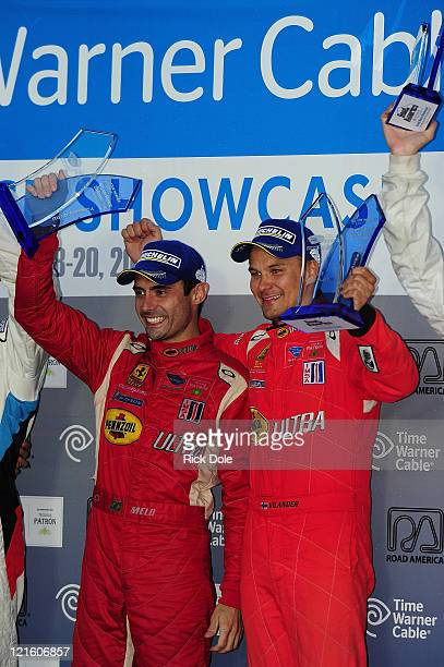 Jaime Melo of Brazil and Toni Vilander of Finland and drivers of the GT class winning Risi Competizione Ferrari 458 Italia celebrate on the podium...