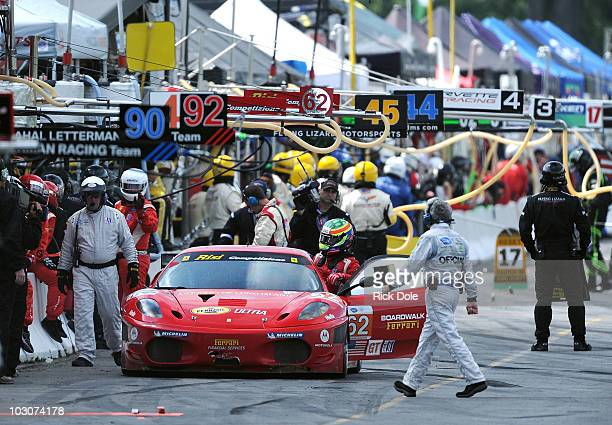 Jaime Melo of Brazil climbs out of the Risi Competizione Ferrari 430 after the car retired from action during the American Le Mans Series Northeast...