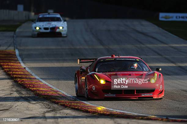 Jaime Melo of Brazil drives the GT class winning Risi Competizione Ferrari 458 Italia during the American Le Mans Series Time Warner Cable Road Race...