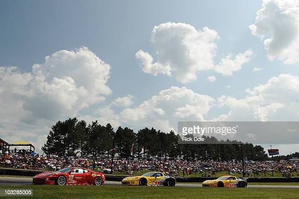 Jaime Melo of Brazil drives the Risi Competizione Ferrari 430 GT and leads the Oliver Gavin of England and Jan Magnussen of Denmark in the and...