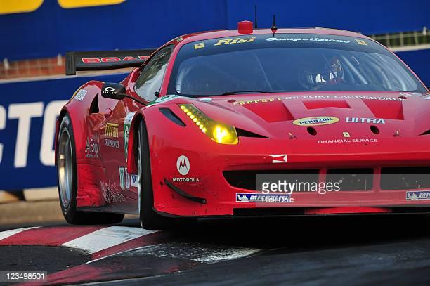 Jaime Melo of Brazil drives the Risi Competizione Ferrari 458 Italia during the American Le Mans Series Baltimore Grand Prix at the Baltimore...