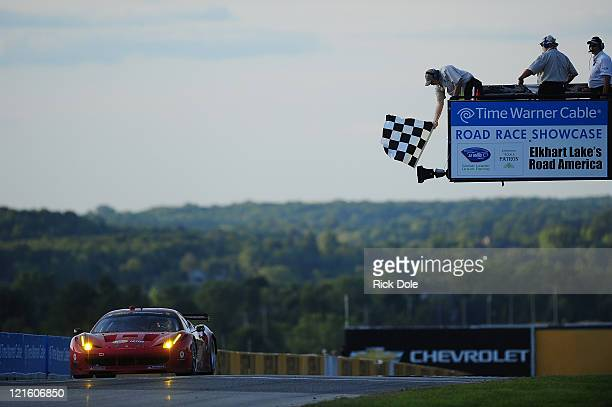 Jaime Melo of Brazil takes the checkered flag driving the GT class winning Risi Competizione Ferrari 458 Italia during the American Le Mans Series...
