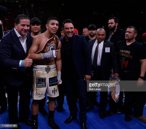 Jaime Munguia celebrates his victory with Oscar De La Hoya over Takeshi Inoue for the WBO Junior Middleweight championship at Toyota Center on...