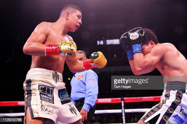 Jaime Munguia of Mexico and Takeshi Inoue of Japan exchange blows during their WBO Jr Middleweight World Title fight at Toyota Center on January 26...