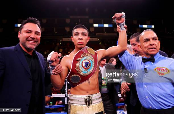 Jaime Munguia of Mexico celebrates after defeating Takeshi Inoue of Japan during their WBO Jr Middleweight World Title fight at Toyota Center on...