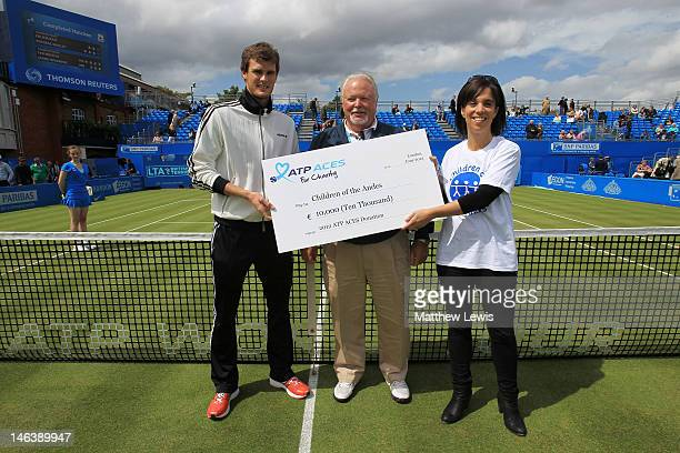 Jaime Murray Tom Barnes and Rachel Joseph hold a check for ATP Aces on day five of the AEGON Championships at Queens Club on June 15 2012 in London...