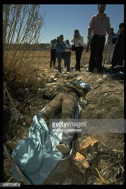 Jaime Murrieta a police photographer on the scene of the crime