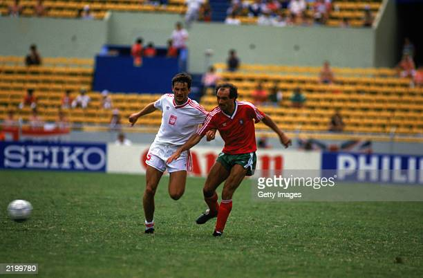 Jaime Pacheco of Portugal crosses the ball as Roman Wojcicki of Poland closes in during the FIFA World Cup Finals 1986 Group F match between Poland...