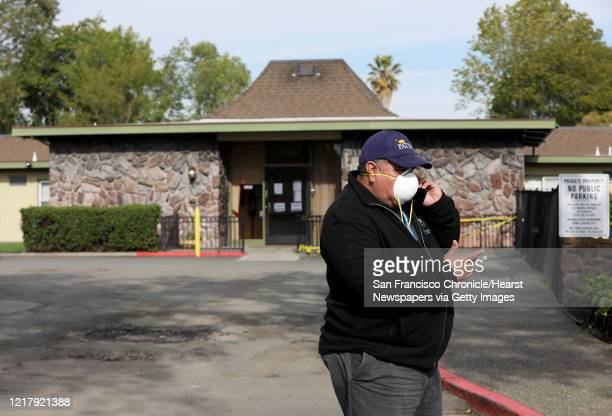 Jaime Patiño a councilmember for Union City speaks with a relative on the phone after visiting his 84yearold grandmother Emma Patiño from outside her...