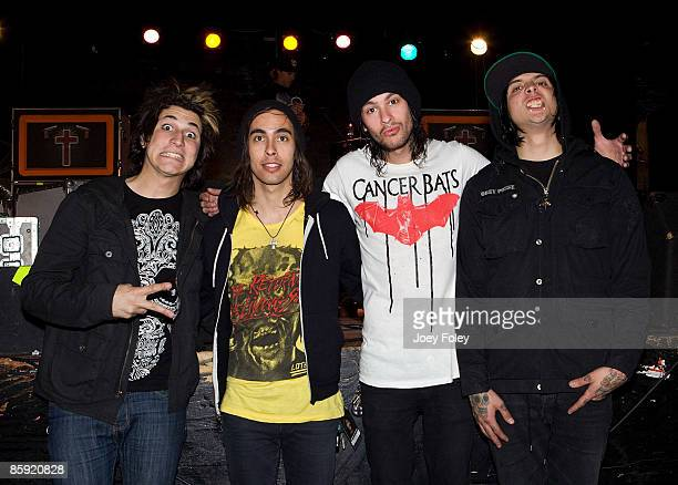 Jaime PreciadoVic FuentesMike Fuentes and Tony Perry of Pierce The Veil pose for a photo after their concert at the Emerson Theater on April 11 2009...
