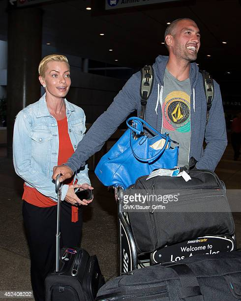 Jaime Pressly and Hamzi Hijazi are seen at LAX on July 19 2014 in Los Angeles California