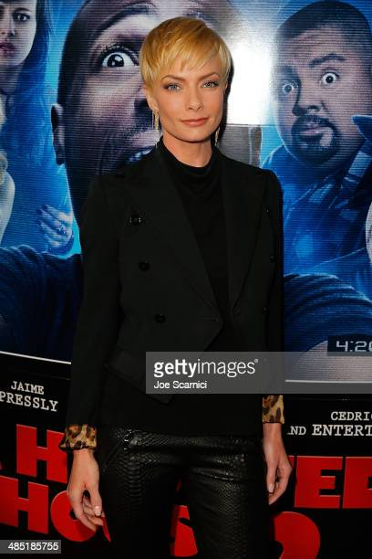 Jaime Pressly walks the 'A Haunted House 2' Los Angeles Premiere Red Carpet at Regal Cinemas LA Live on April 16 2014 in Los Angeles California