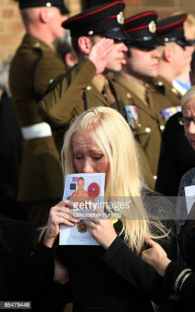 Jaime Quinsey follows the coffin of her brother Sapper Mark Quinsey out of Immanuel Church in Highters Heath after his funeral service on March 18...