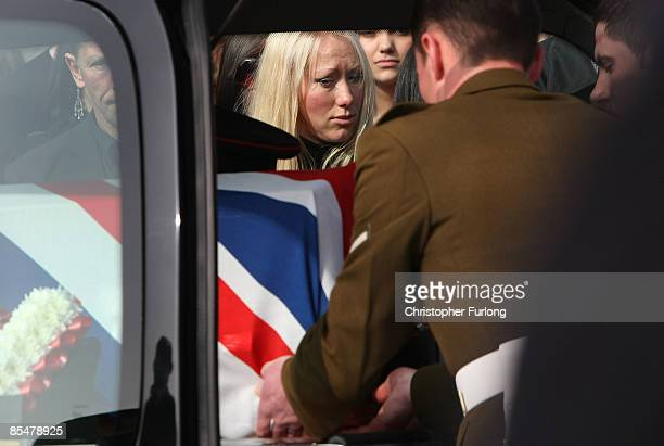 Jaime Quinsey looks on as the coffin of her brother Sapper Mark Quinsey who was murdered in Northern Ireland arrives at Immanuel Church in Highters...