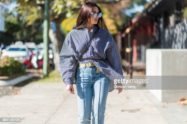Jaime Ridge wearing a button shirt with wide sleeves, denim jeans at day 4 during Mercedes-Benz Fashion Week Resort 18 Collections at Carriageworks...