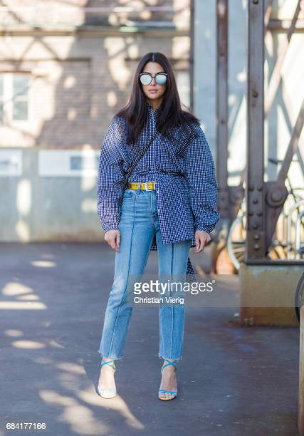 Jaime Ridge wearing a button shirt with wide sleeves denim jeans at day 4 during MercedesBenz Fashion Week Resort 18 Collections at Carriageworks on...