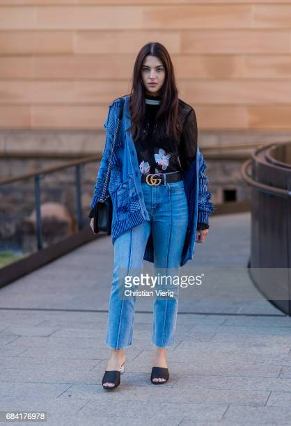 Jaime Ridge wearing wearing HM shoes and jeans Gucci belt Chanel bag Stella McCartney denim sweater Dior sunglasses and Ginger and Smart black sheer...