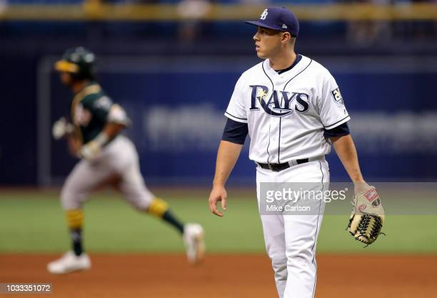 Jaime Schultz of the Tampa Bay Rays reacts after giving up a home run to Khris Davis of the Oakland Athletics in the tenth inning of a baseball game...