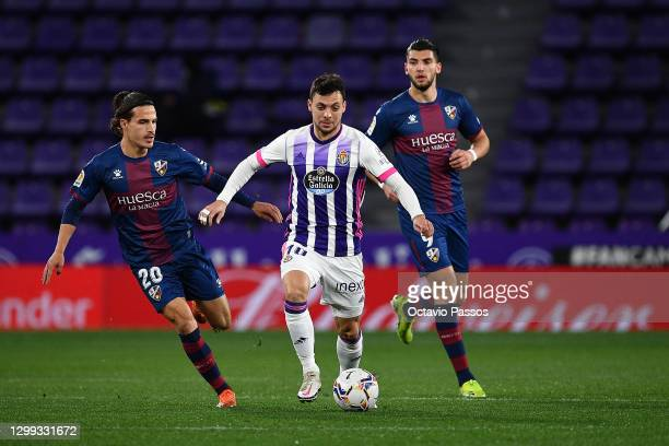 Jaime Seoane of Huesca challenges Óscar Plano of Real Valladolid during the La Liga Santander match between Real Valladolid CF and SD Huesca at...
