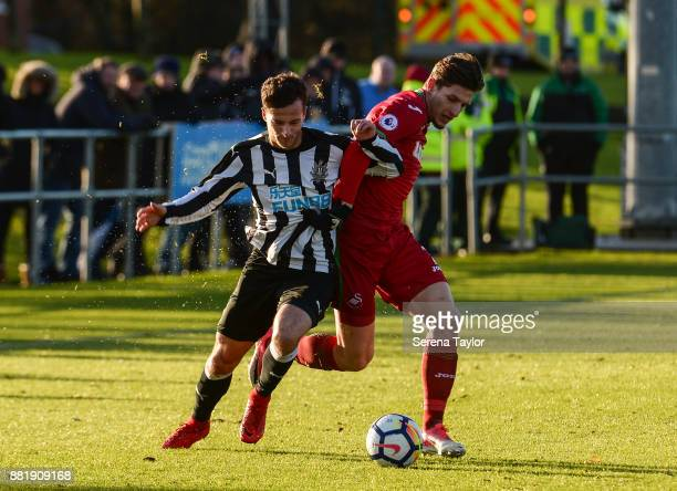 Jaime Sterry of Newcastle United and Adnan Mariac of Swansea City jostle for the ball during the Premier League 2 match between Newcastle United and...