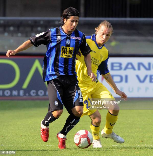 Jaime Valdes of Atalanta BC competes for the ball with Nicolas Sebastien Frey of Chievo Verona during the Serie A match between Chievo Verona and...