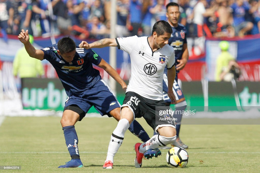 Jaime Valdes of Colo Colo fights for the ball with Matias Rodriguez of U de Chile during a match between U de Chile and Colo Colo as part of Torneo Scotiabank 2018 at Nacional Stadium of Chile on April 15, 2018 in Santiago, Chile.