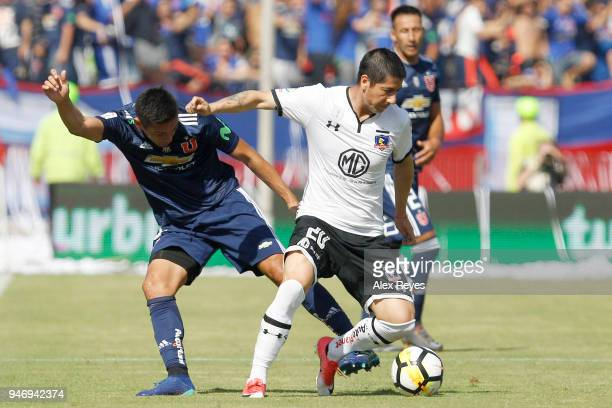 Jaime Valdes of Colo Colo fights for the ball with Matias Rodriguez of U de Chile during a match between U de Chile and Colo Colo as part of Torneo...