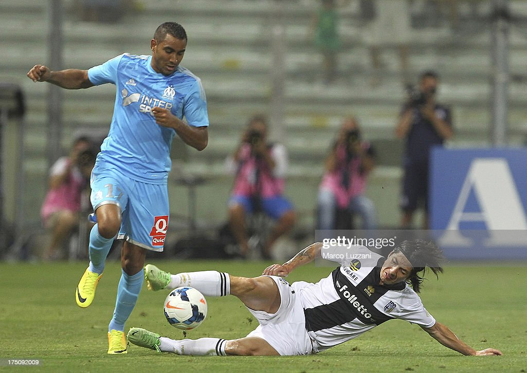 Jaime Valdes (R) of Parma FC competes for the ball with Dmitri Payet (L) of Olympique de Marseille during the pre-season friendly match between Parma FC and Olympique de Marseille at Stadio Ennio Tardini on July 31, 2013 in Parma, Italy.