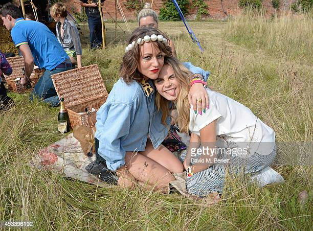 Jaime Winstone and Cara Delevingne attend The Mulberry Wilderness Picnic with Cara Delevingne during Wilderness 2014 at Cornbury Park on August 9...