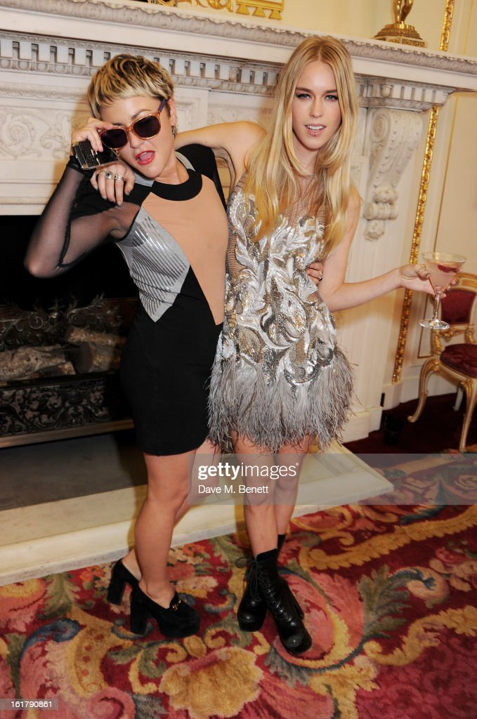 Jaime Winstone (L) and Mary Charteris pose backstage at the Julien Macdonald show during London Fashion Week Fall/Winter 2013/14 at Goldsmiths' Hall on February 16, 2013 in London, England.
