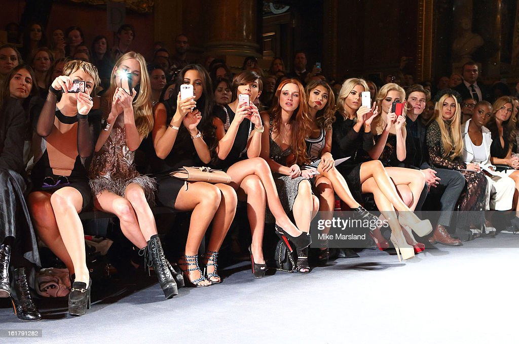 Jaime Winstone, Frankie Sandford, Rochelle Wiseman, Mollie King, Una Healy, Vanessa White and Pixi Lott attend the Julien Macdonald show during London Fashion Week Fall/Winter 2013/14 at Goldsmiths' Hall on February 16, 2013 in London, England.