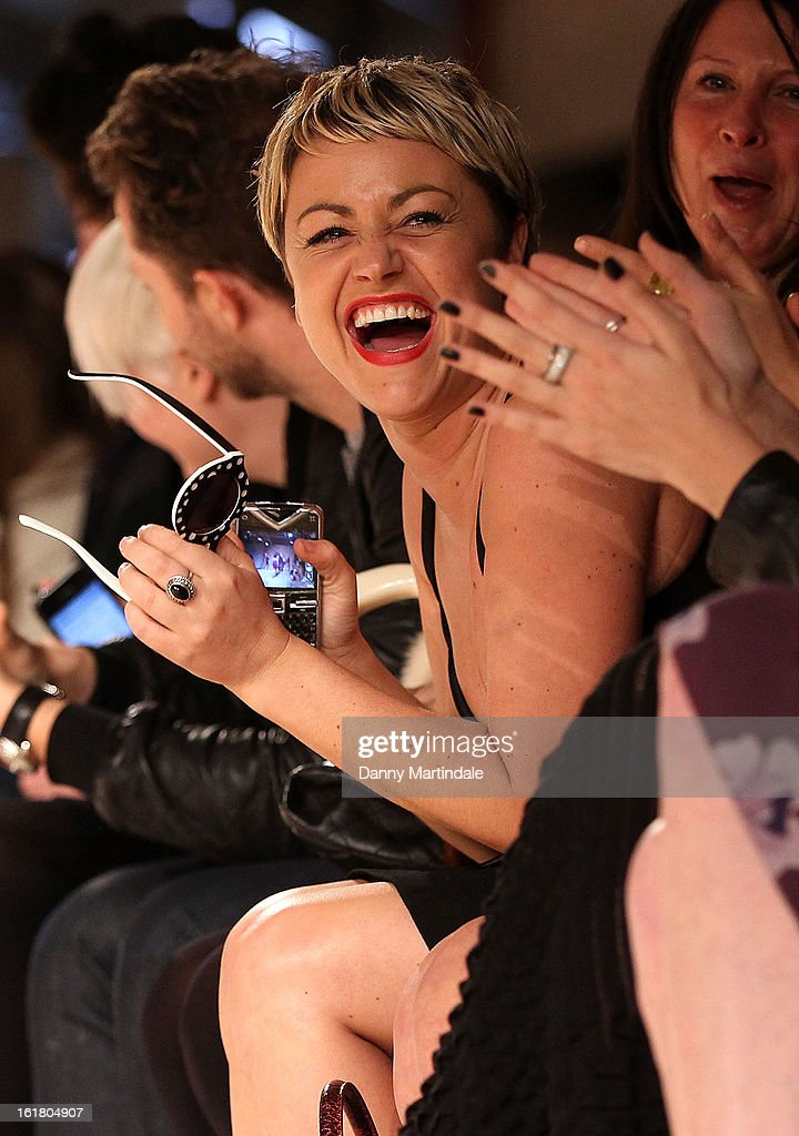 Jaime Winstone is seen joking with friends at the House of Holland show during London Fashion Week Fall/Winter 2013/14 at Brewer Street Car Park on February 16, 2013 in London, England.