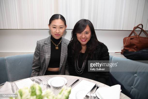 Jamie Xie and Erica Jang pose for a photo at the opening of Freds at Barneys New York San Francisco on September 26 2018 in San Francisco California