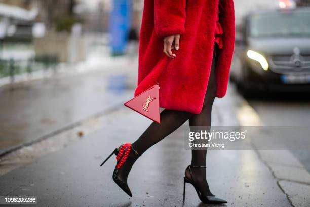 Jamie Xie is seen wearing Alexandre Vauthier skirt Saint Laurent bag Saint Laurent heels sheer tights red teddy coat outside Alexandre Vauthier...