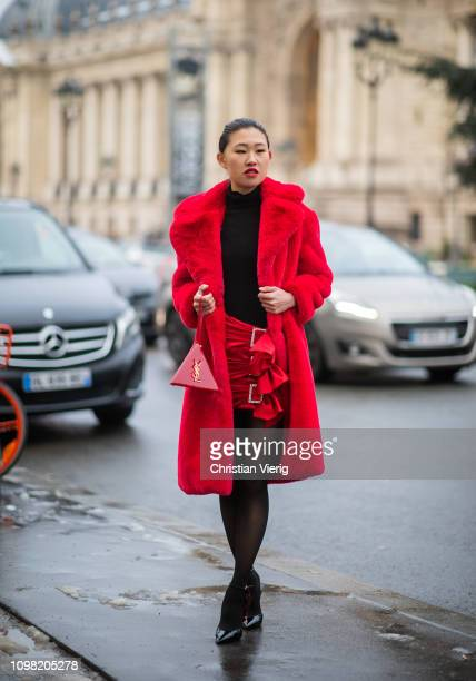 Jamie Xie is seen wearing black Gucci top Alexandre Vauthier skirt Saint Laurent bag Saint Laurent heels sheer tights red teddy coat outside...