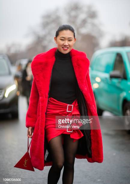 Jamie Xie is seen wearing black Gucci top Alexandre Vauthier skirt Saint Laurent bag sheer tights red teddy coat outside Alexandre Vauthier during...