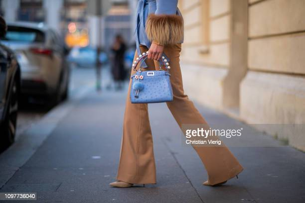 Jaime Xie is seen wearing light blue Prada jacket beige Max Mara pants Fendi bag during Paris Fashion Week Haute Couture Spring Summer 2019 on...