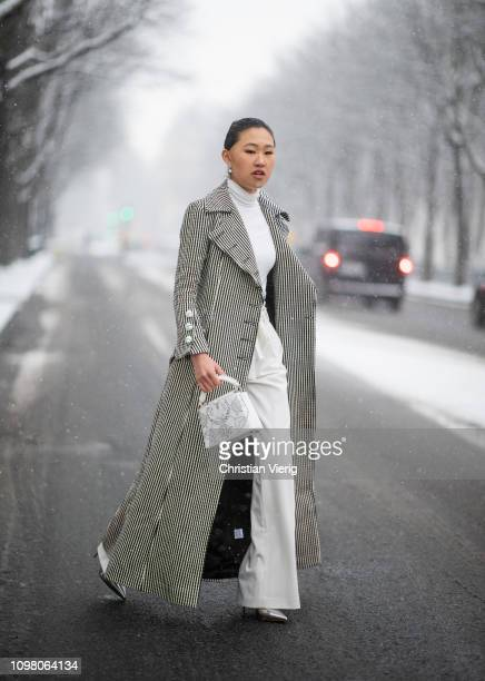 Jaime Xie is seen wearing Marques Almeida coat white Louis Vuitton bag Christian Louboutin shoes white turtleneck outside Chanel on January 22 2019...