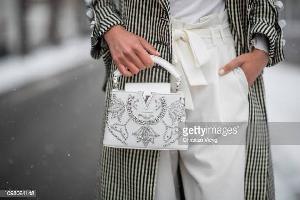 Jaime Xie is seen wearing Marques Almeida coat white Louis Vuitton bag white turtleneck outside Chanel on January 22 2019 in Paris France