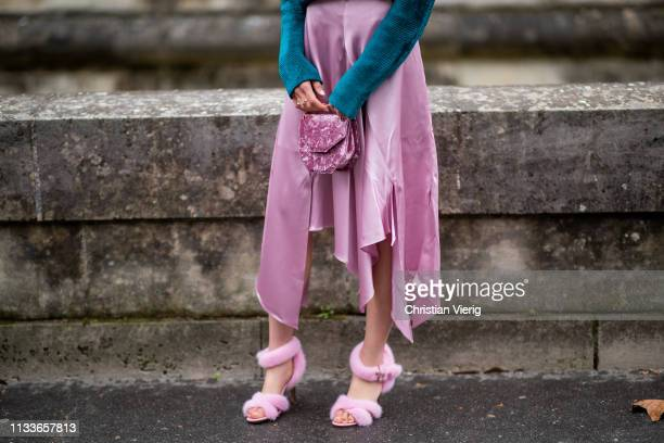 Jaime Xie is seen wearing pink silk skirt, turquoise turtleneck outside Valentino during Paris Fashion Week Womenswear Fall/Winter 2019/2020 on March...