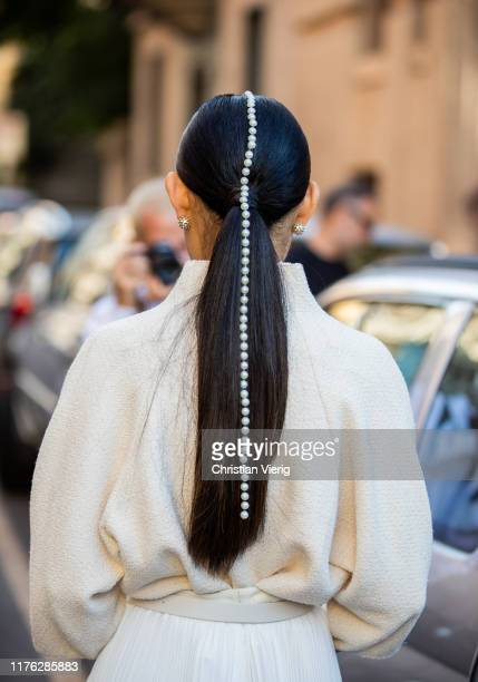 Jaime Xie seen wearing pearls hair piece white outside the Ferragamo show during Milan Fashion Week Spring/Summer 2020 on September 21 2019 in Milan...