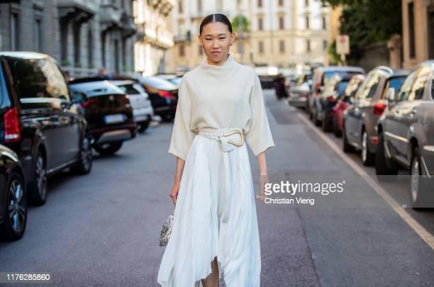 Jaime Xie seen wearing white skirt with slits silver bag jumper outside the Ferragamo show during Milan Fashion Week Spring/Summer 2020 on September...