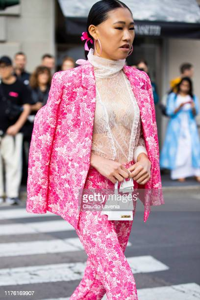Jaime Xie, wearing a floral pink woman's suit and Jacquemus bag, is seen outside the Blumarine show during Milan Fashion Week Spring/Summer 2020 on...
